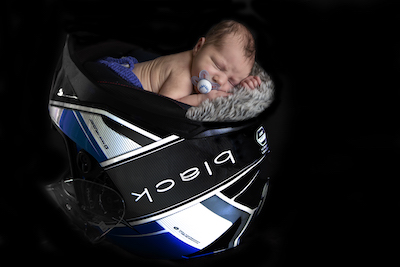 Newborn Photography in a Motorbike Helmet - Emma Lowe Photography in Rugby